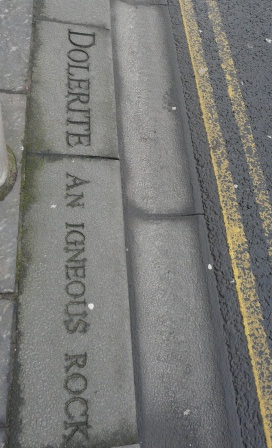 Some of Edinburgh's streets are lined and paved with dolerite to this day. This example (inscribed outside the Scottish Parliament) may be the world's only example of a gutter with mineralogical engraving.