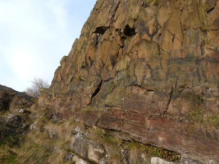 Dolerite (cooled lava flow) on top. Sedimentary rock below.