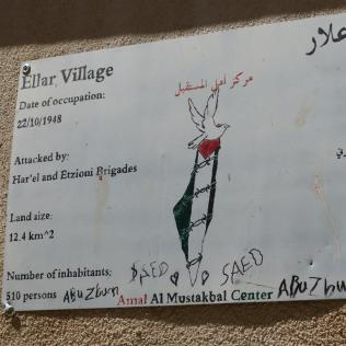 Former homes commemorated on wall signs in town. The painted map appears to leave no room for the State of Israel, a depiction that points away from peaceful coexistence, rather than toward it.