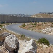 Jerusalem is on the other side of the wall. No riding into town on a donkey.