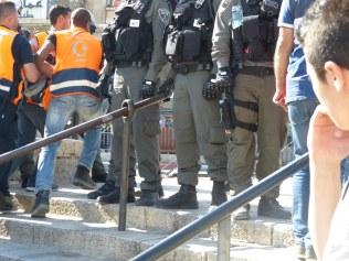 palestinian-medics-carry-injured-past-israeli-security