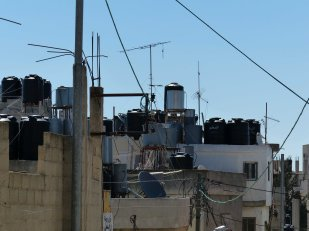 Water cisterns on rooftops in Palestinian refugee camp, Bethlehem